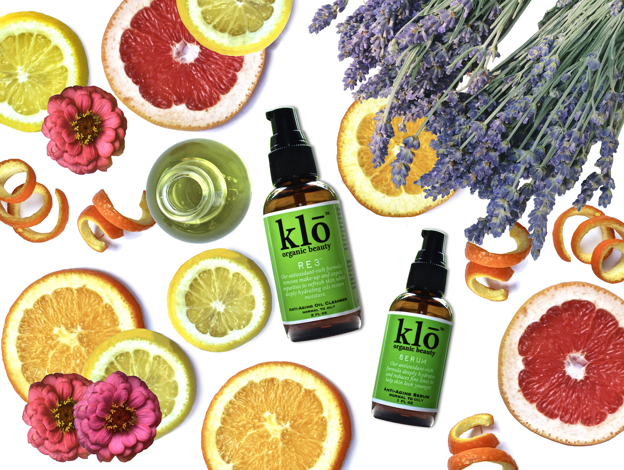 Klō Organic Beauty oil cleanser and serum duo with flowers and citrus