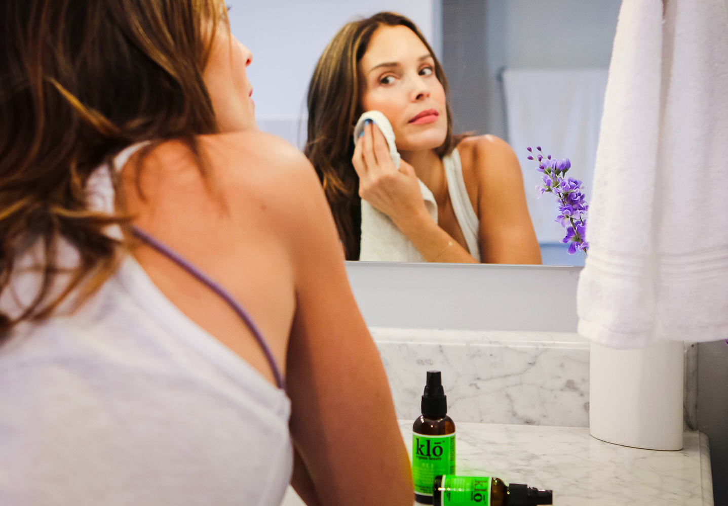 Woman uses Klo Organic Beauty for oily acne-prone skin