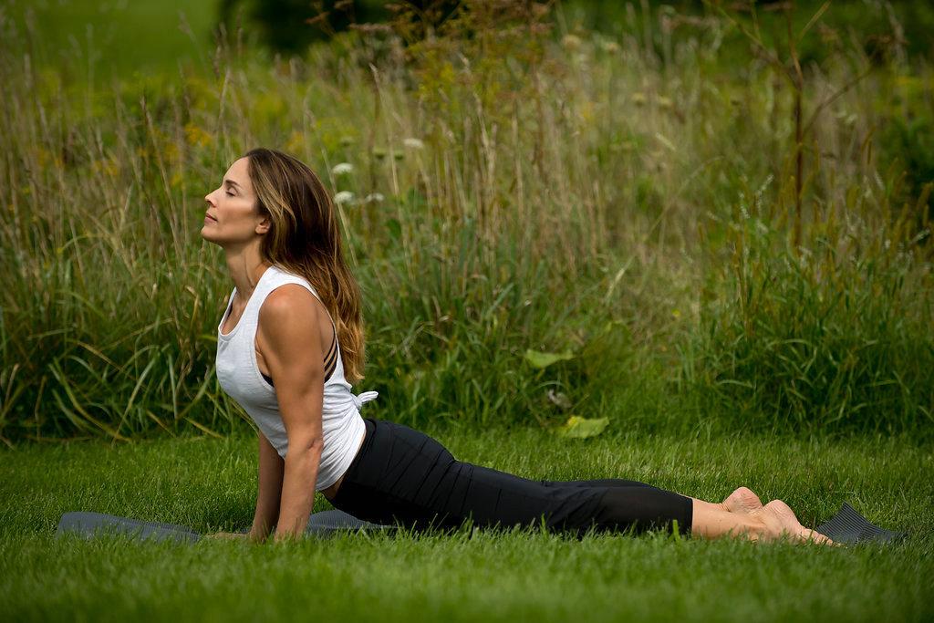 Klo Organic Beauty model relaxing in yoga pose
